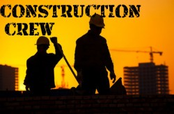 Silhouette of men constructing a building with a yellow background