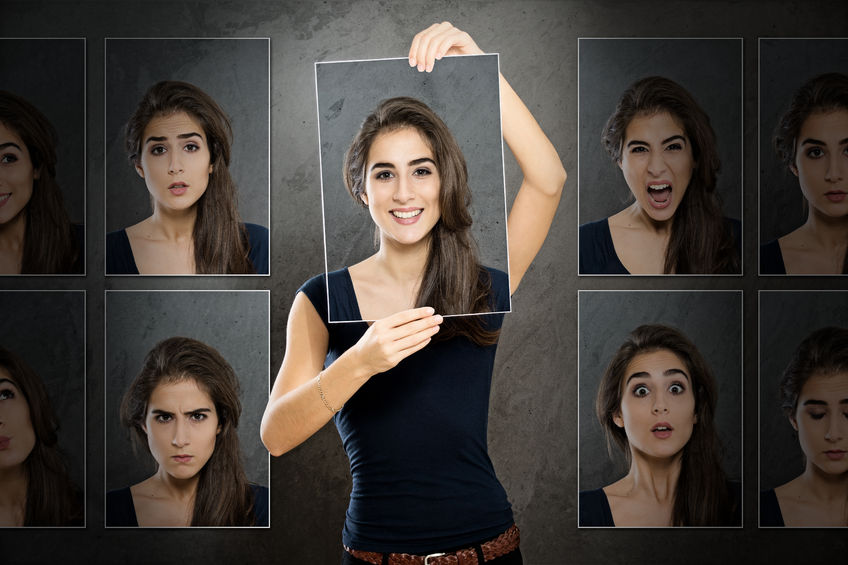 Woman showing portraits of different emotions, anger, happiness, fear