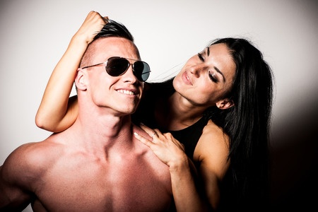 woman grabbing muscular chad man's hair