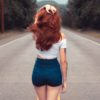 red haired woman with dark denim shorts