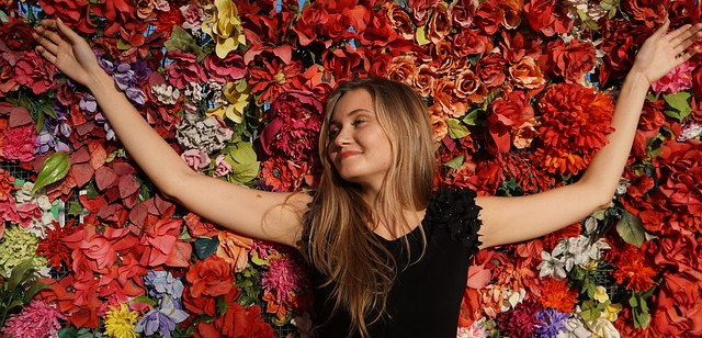 girl laying in a bed of flowers