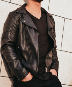 Man in leather jacket with black v-neck shirt
