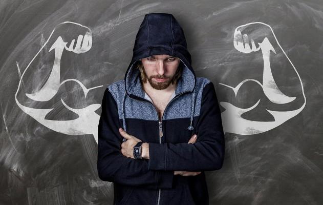 Man imagining strong flexing muscles