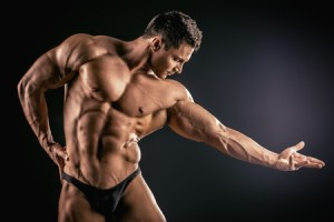 Muscular man posing and flexing