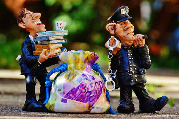 Clay character figures of wealthy business man and police officer