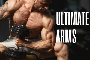 Muscular tanned man lifting weights with biceps