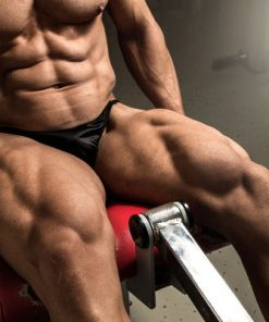 Large muscular man doing leg extensions