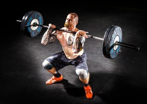 Man doing clean and press or clean and jerk